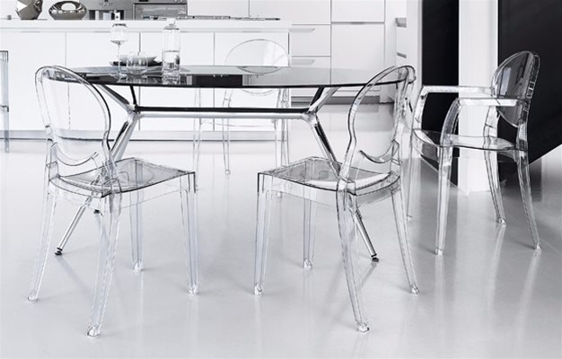 metropolis glass and chrome table with igloo clear plastic armchairs in a white kitchen | Inspiration